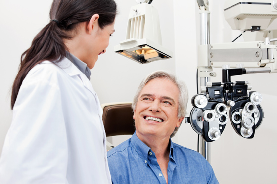 man have eye test with optometrist